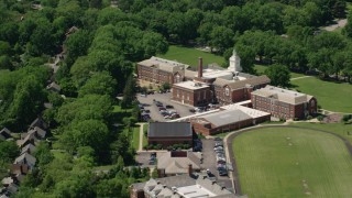 AX106_190 - 5K stock footage aerial video orbiting an elementary school in Shaker Heights, Ohio