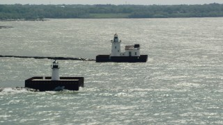 AX106_208 - 5K stock footage aerial video of two lighthouses on Lake Erie in Cleveland, Ohio