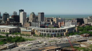 AX106_220 - 5K stock footage aerial video of Progressive Field baseball stadium in Downtown Cleveland, Ohio
