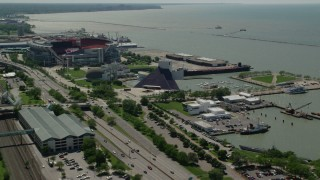 AX106_227 - 5K stock footage aerial video of the Rock and Roll Hall of Fame in Downtown Cleveland, Ohio