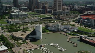 AX106_229 - 5K stock footage aerial video of Rock and Roll Hall of Fame and Great Lakes Science Center in Downtown Cleveland, Ohio