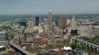 AX106_246 - 5K stock footage aerial video approaching skyscrapers in Downtown Cleveland, Ohio