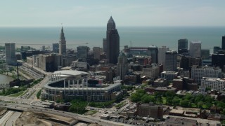 AX106_258 - 5K stock footage aerial video approaching Progressive Field and Skyscrapers in Downtown Cleveland, Ohio