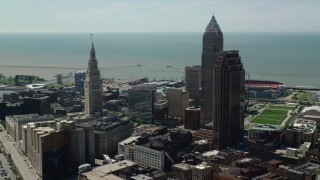 AX106_260 - 5K stock footage aerial video flying between Terminal Tower and 200 Public Square in Downtown Cleveland, Ohio