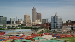 AX107_016 - 5K stock footage aerial video of Downtown Cleveland skyline from the shores of Lake Erie, Ohio