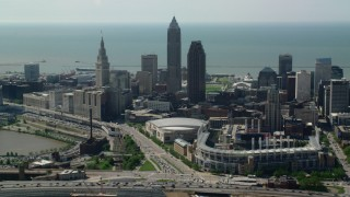 AX107_029 - 5K stock footage aerial video flying by Downtown Cleveland from Progressive Field, Ohio