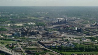 AX107_047 - 5K stock footage aerial video of factories along a river, Cleveland, Ohio