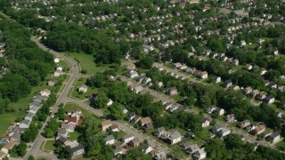 AX107_050 - 5K stock footage aerial video flying over residential neighborhood, Cleveland, Ohio