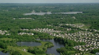 AX107_068 - 5K stock footage aerial video flying over lakeside neighborhood toward Aurora Lake, Aurora, Ohio