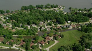 AX107_069 - 5K stock footage aerial video flying over lakeside homes, Aurora, Ohio