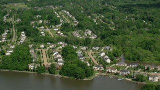 AX107_070 - 5K stock footage aerial video of upscale homes near the water, Aurora, Ohio