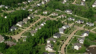 AX107_071 - 5K stock footage aerial video flying along upscale homes, Aurora, Ohio