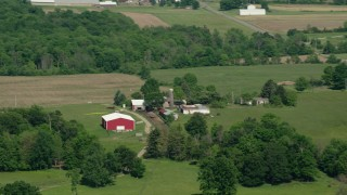 AX107_078 - 5K stock footage aerial video of a farm with a red barn, Aurora, Ohio