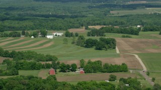 AX107_080 - 5K stock footage aerial video of farms and farmland, Mantua, Ohio