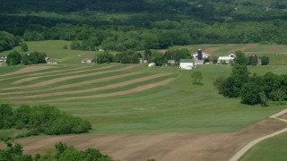 AX107_081 - 5K stock footage aerial video passing by farms, Mantua, Ohio