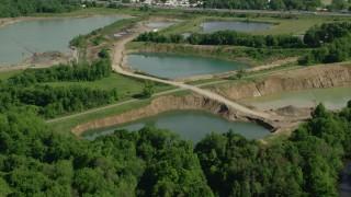 AX107_083 - 5K stock footage aerial video of small lakes, Ravenna, Ohio