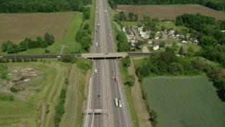 AX107_085 - 5K stock footage aerial video of an interstate running along farmland, Ravenna, Ohio
