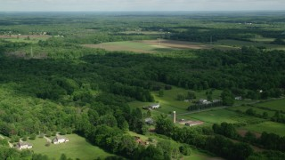 AX107_086 - 5K stock footage aerial video of farms and trees, Ravenna, Ohio
