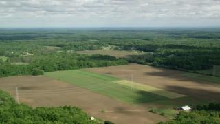 AX107_088 - 5K stock footage aerial video of farmland and trees, Ravenna, Ohio
