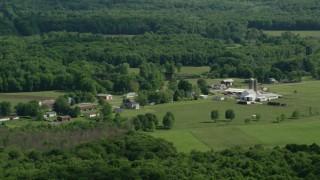 AX107_089 - 5K stock footage aerial video of barns and farmland, Ravenna, Ohio