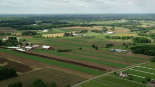 AX107_095 - 5K stock footage aerial video of farms and farmland, Newton Falls, Ohio