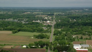 AX107_098 - 5K stock footage aerial video of farmland and small town, Columbiana, Ohio