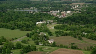 AX107_099 - 5K stock footage aerial video of a small town and trees, Columbiana, Ohio