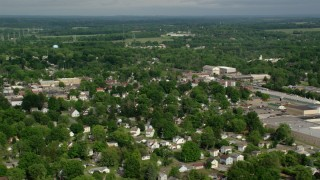 AX107_100 - 5K stock footage aerial video of homes and small town, Columbiana, Ohio