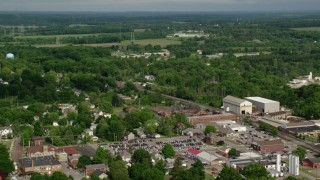 AX107_101 - 5K stock footage aerial video flying over small town toward a school, Columbiana, Ohio