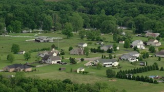 AX107_109 - 5K stock footage aerial video of approaching rural homes, New Waterford, Ohio