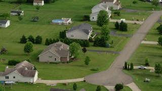 AX107_110 - 5K stock footage aerial video orbiting a rural home, New Waterford, Ohio