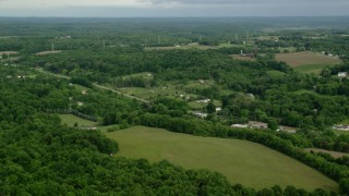 AX107_112 - 5K stock footage aerial video of rural neighborhood and trees, East Palestine, Ohio