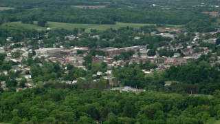 AX107_115 - 5K stock footage aerial video flying by small town, East Palestine, Ohio