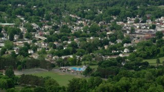 AX107_117 - 5K stock footage aerial video passing a small town, East Palestine, Ohio