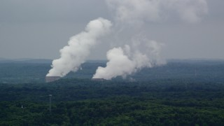 AX107_124 - 5K stock footage aerial video of steam rising from a power station's cooling towers, Beaver Valley Power Station, Pennsylvania