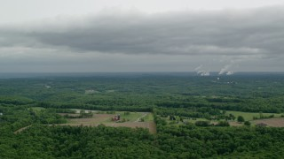 AX107_126 - 5K stock footage aerial video of farms, forests and Beaver Valley Power Station, Pennsylvania
