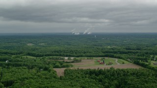 AX107_127 - 5K stock footage aerial video of forests and Beaver Valley Power Station, Pennsylvania