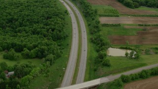 AX107_129 - 5K stock footage aerial video of an interstate running along forests and farmland, Beaver Falls, Pennsylvania
