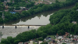 AX107_131 - 5K stock footage aerial video of a dam on a river, Beaver Falls, Pennsylvania