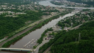 AX107_132 - 5K stock footage aerial video of three bridges spanning a river near a town, Beaver, Pennsylvania