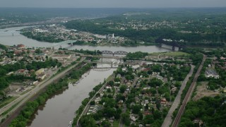 AX107_133 - 5K stock footage aerial video approaching three bridges spanning a river near a town, Beaver, Pennsylvania