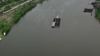 AX107_137 - 5K stock footage aerial video approaching a barge on the river, Ohio River, Monaca, Pennsylvania