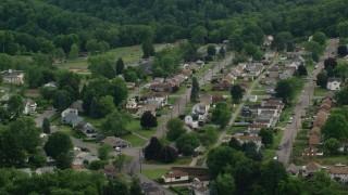 AX107_138 - 5K stock footage aerial video orbiting a residential neighborhood, Monaca, Pennsylvania