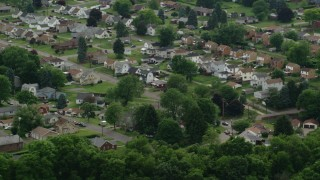 AX107_139 - 5K stock footage aerial video of a residential neighborhood among trees, Monaca, Pennsylvania