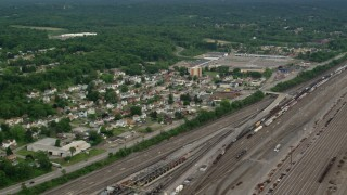 AX107_140 - 5K stock footage aerial video of homes near a rail yard, Conway, Pennsylvania