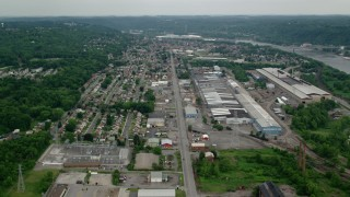 AX107_146 - 5K stock footage aerial video of homes and small factories, Ambridge, Pennsylvania