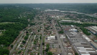AX107_147 - 5K stock footage aerial video flying over homes and small factories, Ambridge, Pennsylvania
