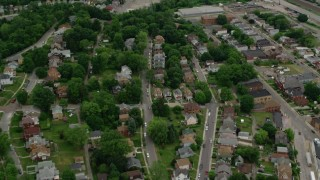 AX107_151 - 5K stock footage aerial video tilting up from homes to reveal warehouses along Ohio River, Leetsdale, Pennsylvania