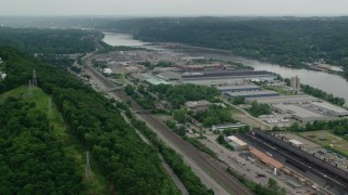 AX107_152 - 5K stock footage aerial video approaching warehouses along Ohio River, Leetsdale, Pennsylvania