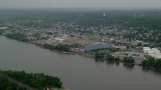 AX107_155 - 5K stock footage aerial video of a warehouse along the river, Coraopolis, Pennsylvania